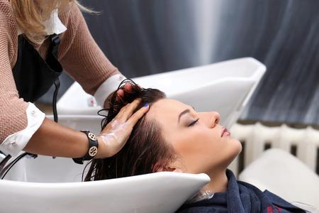 washing hair: Hairdresser salon  Woman during hair wash