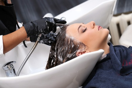 Hairdresser salon  Woman during hair wash photo