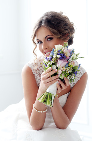 bridal hair: Wedding  Beautiful bride with bouquet