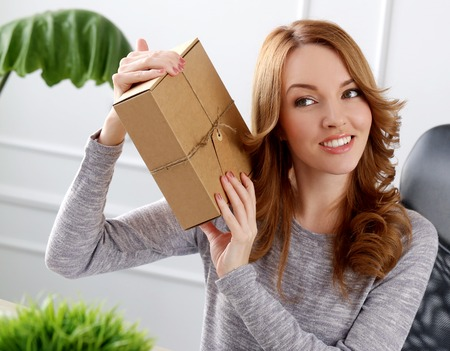 Lifestyle  Cute girl with package