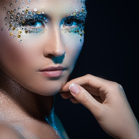 Beautiful girl with artistic make-up photo