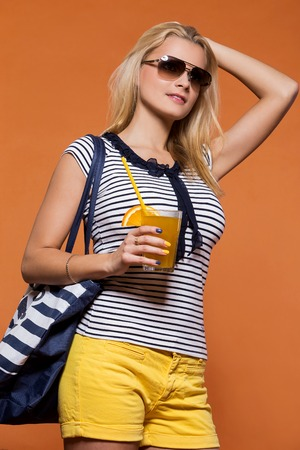 Summertime  Attractive girl with juice photo