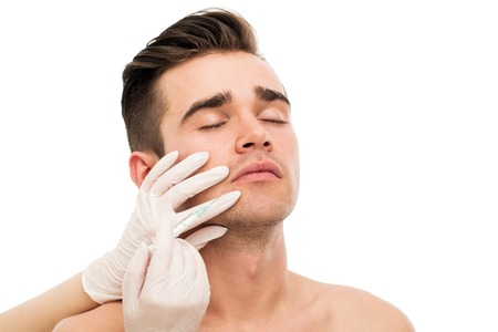 Plastic surgery  Handsome man on a white background photo