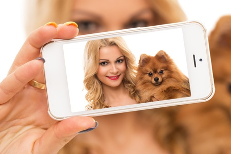 Selfie  Cute woman with dog photo