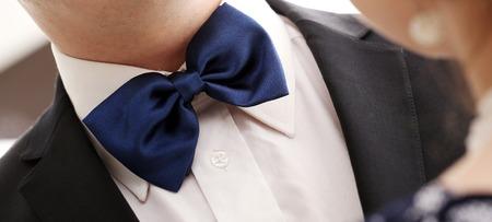 Gentleman in tuxedo and blue bow tie photo