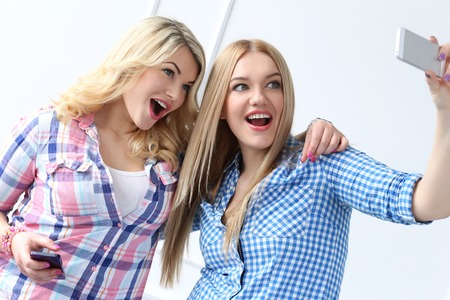 youngster  girl: Two best friends with mobile phone