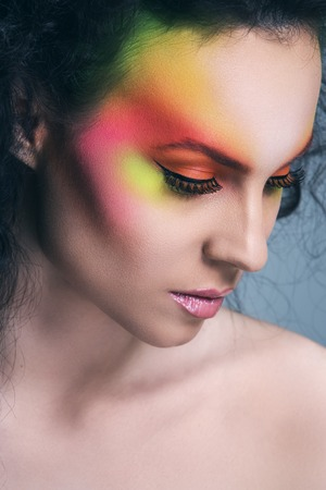 Beautiful girl with colored make-up photo