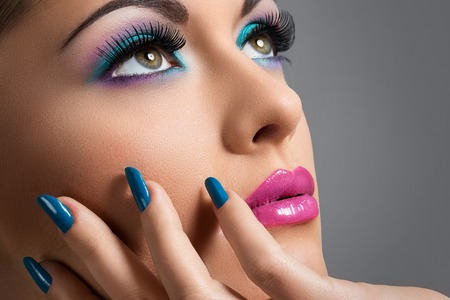 cosmetic lacquer: Cute, attractive woman with colorful makeup