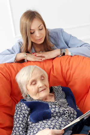 Close-up  Elderly woman and beautiful granddaughter Stock Photo - 27884482