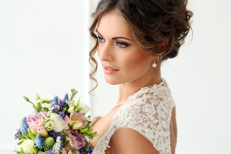 Wedding  Attractive bride with bouquet