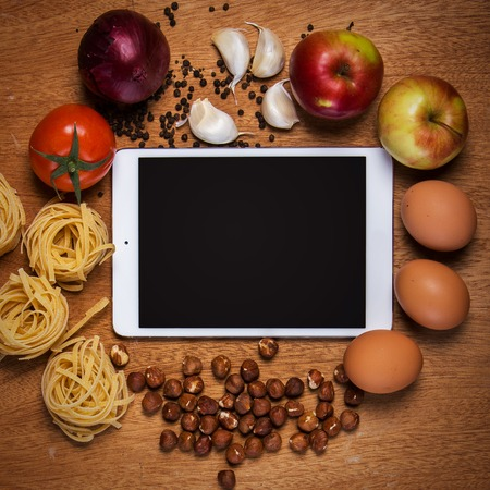 Kitchen  Tablet and food on the table photo