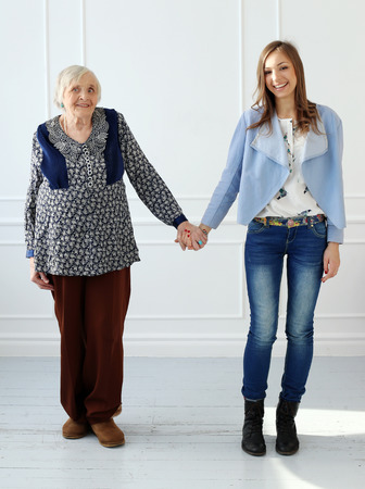 Elderly woman and beautiful granddaughter photo