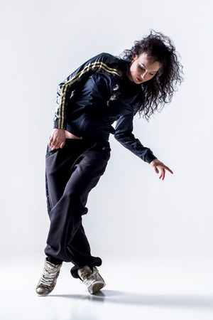 Hip-hop dancer on a white background photo