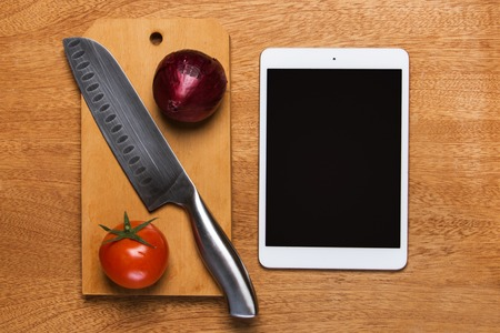 Kitchen  Knife and tablet on the table photo