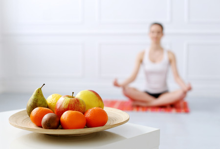 indoors: Lifestyle  Cute, attractive woman during yoga exercise Stock Photo