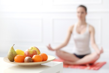 Lifestyle  Cute, attractive woman during yoga exercise Stock Photo