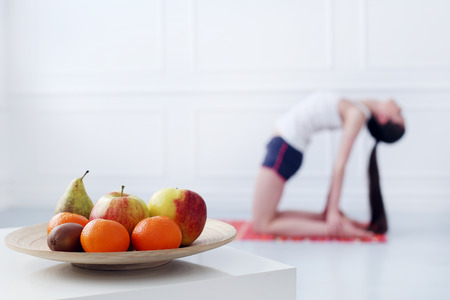 Lifestyle  Cute, attractive woman during yoga exercise photo