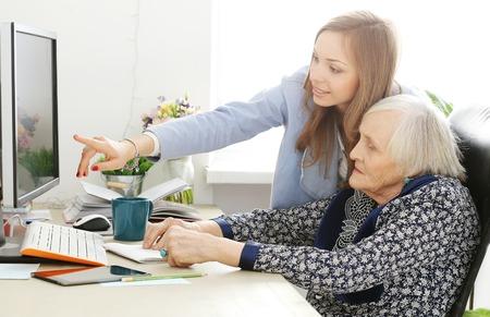 Elderly woman and beautiful teacher photo