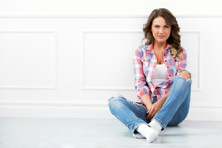 Lifestyle  Cute, attractive woman on the floor photo