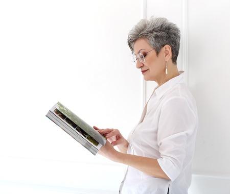 Elderly  Happy woman with magazine Stock Photo - 28002360