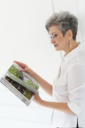 Elderly  Happy woman with magazine Stock Photo - 28002372