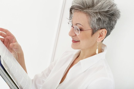Elderly  Happy woman with magazine Stock Photo - 28002382