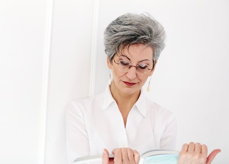 Elderly  Happy woman reading magazine Stock Photo - 28002813