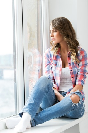 Lifestyle  Cute, attractive woman by the window photo
