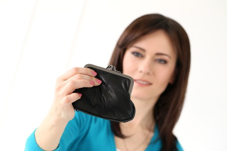 Cute, attractive woman with wallet photo