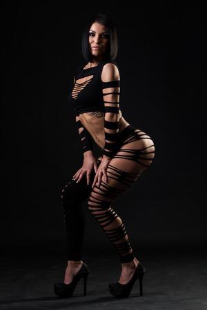 Beautiful, sexy woman in fetish dress photo