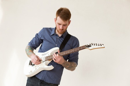 Handsome man playing on guitar photo