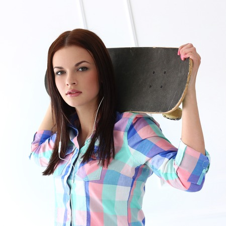 Cute, attractive teenager with skateboard photo