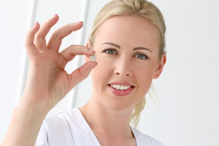 cosmetologist: Pharmacist  Beautiful cosmetologist in the hospital Stock Photo