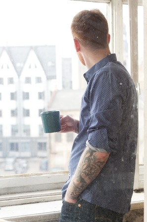 Handsome guy with cup of tea photo