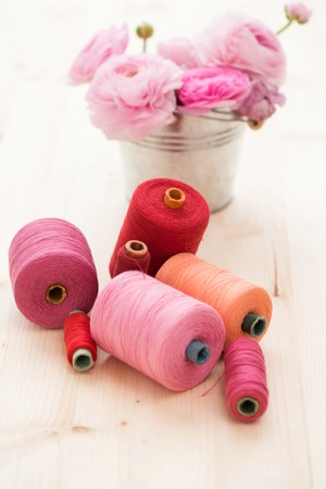 Tailoring  Threads and flowers on the table photo