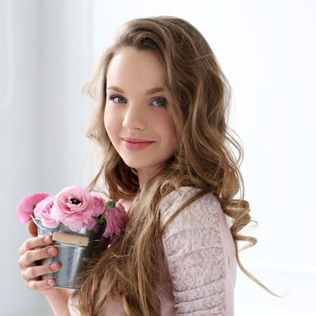 Cute, young girl with flowers photo