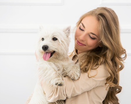 Attractive woman with dog photo