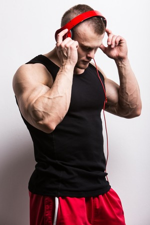 Fitness, bodybuilding  Powerful man with red headset photo