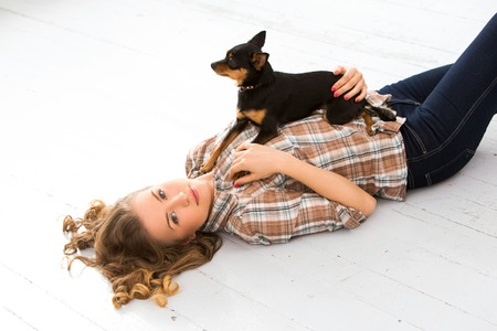 Attractive woman with dog on the floor photo