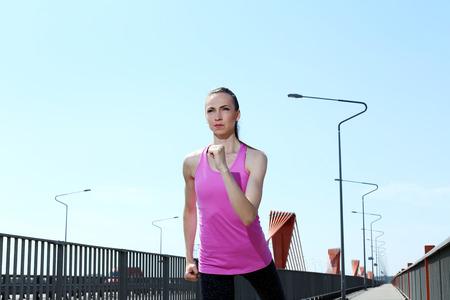 woman running on the street photo