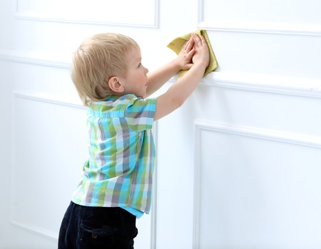 dirty blond: Cute kid helping with cleaning