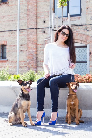 Outdoor  Cute, attractive girl with beautiful dogs