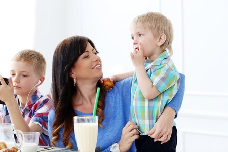 Mother and two brothers during family breakfast photo