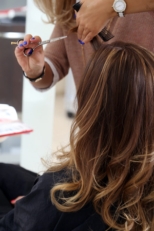 girl with new hairstyle with hairdresser in salon photo