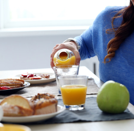 Woman during breakfast at home photo