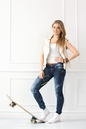 cute house: Cute, attractive girl with skateboard