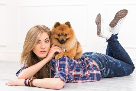 Cute, attractive girl with fluffy dog photo
