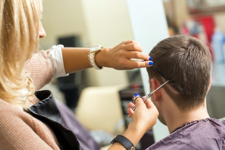 Hairdresser cut a Man hair photo