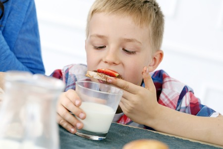 Young boy with glass of milk photo