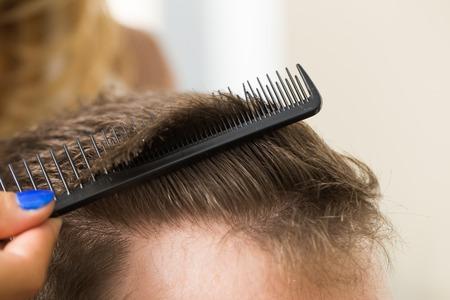 Hairdresser salon  Man during haircut photo